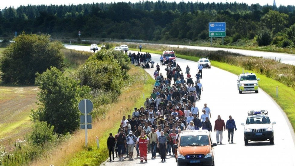 Migrants walk on the E45 freeway at Padborg, while trying to head to Sweden September 9, 2015