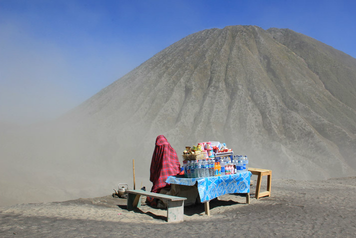 """This vendor at Mount Bromo, Indonesia, covers her body and face with a sarong to protect herself against the dusty wind that blows constantly around the crater."" Grandis Syahrulli."