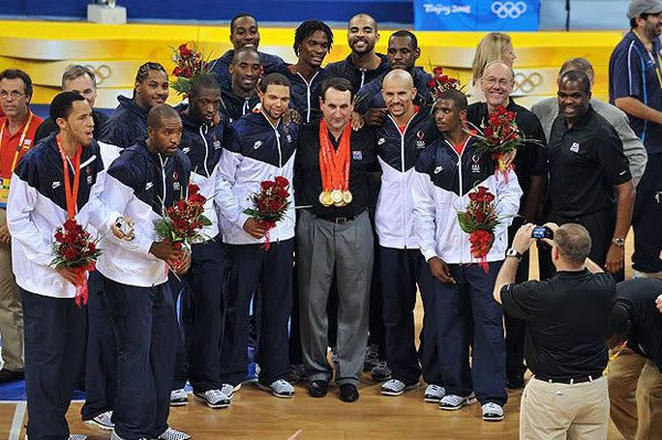 The players and coaches for the Redeem Team pose for a group photo after defeating Spain, 118-107, in the gold-medal basketball game in Beijing, China...on August 24, 2008.