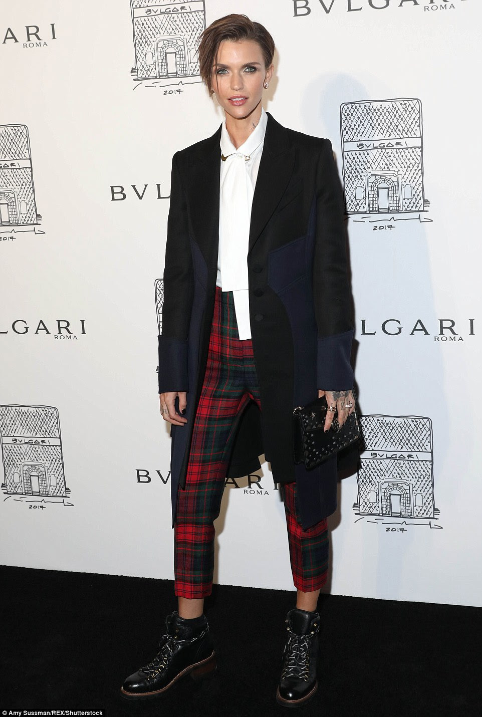 Mad for plaid: Ruby Rose  looked fashionable as always in cropped patterned trousers