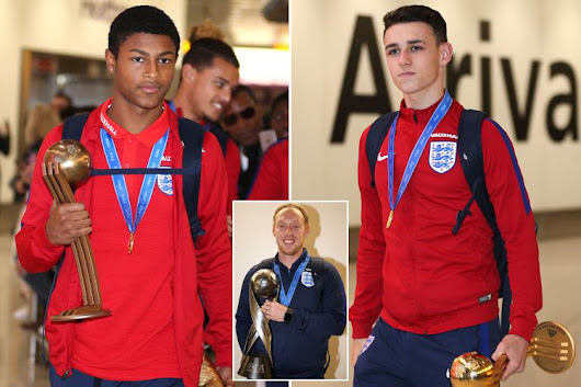 England Under-17s arrive at Heathrow clutching the World Cup trophy to a heroes' welcome after famously w