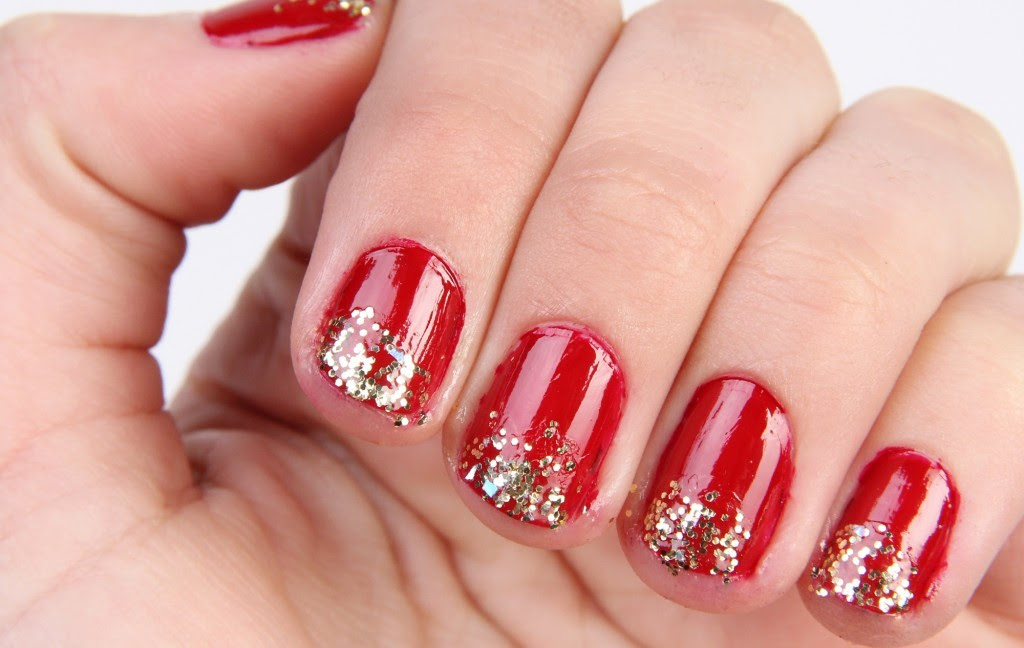 Glitter Gradient Manicure | The Perfect Fit I must have missed the memo about glitter tip manicures because it seems everyone at work is rocking this look right now! Though I like this with the red, the look I really love is with a pearly polish and gold glitter. It makes me think of snow globes!