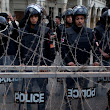 Egyptian President Morsi leaves presidential palace as protests turn violent