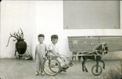 Two boys and a riding toy