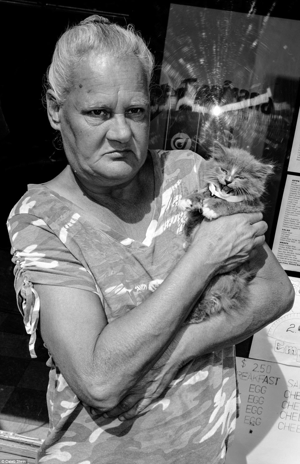 Photographer Caleb Stein captured the images as part of an ongoing project titled 'Down by the Hudson'. Pictured above is a woman named Karen with a cat on Main Street