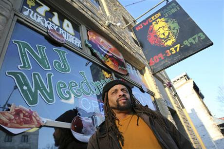 "Ed Forchion, a pro-marijuana activist known as NJ Weedman, stands in front of his Weedman's Joint restaurant Monday, March 7, 2016, in Trenton, N.J. After years of legal fights over marijuana from coast to coast, NJ Weedman appeared to be going legit with a new restaurant in New Jersey's capital city. But after Trenton officials shutdown the attached cannabis ""temple"" Saturday night for operating too late at night, Forchion says he's headed back to court. (AP Photo/Mel Evans)"