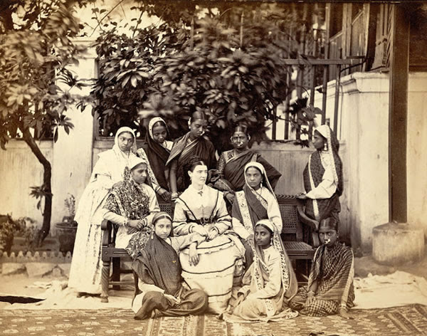 European Mistress Seated in the Centre of a Group of Ten Female Pupils, Government Normal School, Bombay (Mumbai) - 1873