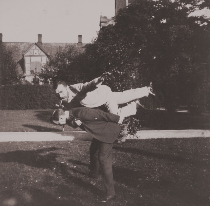 Tsar Nicholas II goofing around with his friend in 1899.