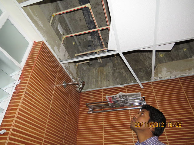 Swapnil shows water seepage & leakage in the common toilet of his flat in Sangria Towers, Megapolis, Hinjewadi Phase 3, Pune