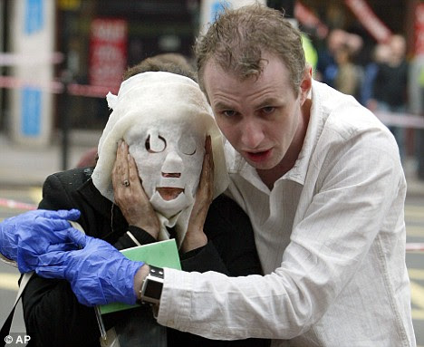 Fateful day: The iconic image of a 7/7 Tube victim wearing a burns mask