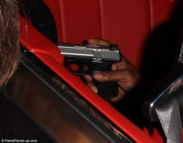 Scary: One of the rapper's friends was seen with a handgun in the vehicle; a young female fan was posing for a picture next to the car at the time