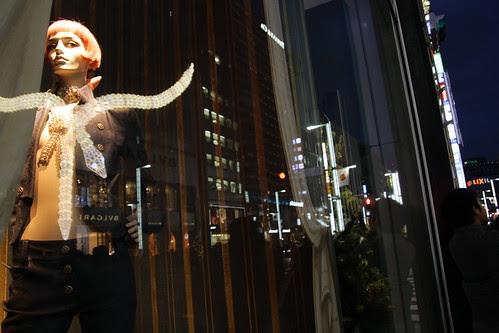 Mannequin looking at Bulgari building