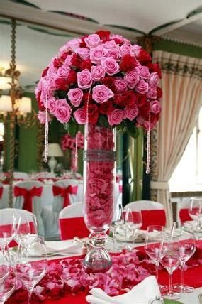 Tall red and pink wedding centerpiece   Rolling Meadows