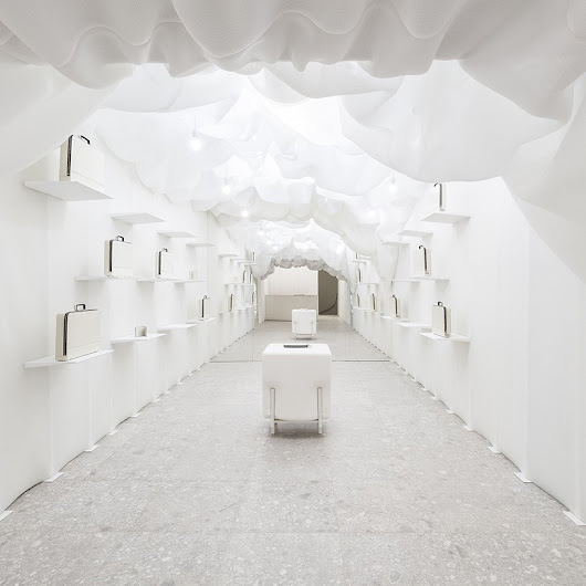 snarkitecture creates ethereal all-white pop-up inside valextra's milan store