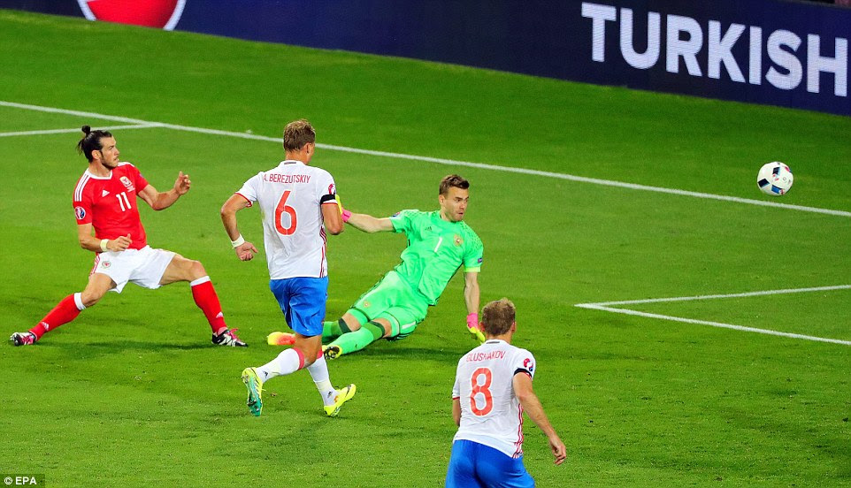 Real Madrid maestro Gareth Bale (left) hits home with the outside of his left boot to land a 67th-minute goal for Wales