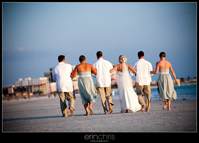 Wedding party walking on the beach at the Grand Plaza on St. Pete Beach