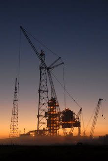 The Sun is about to rise as construction cranes loom around Launch Pad 39-B at Kennedy Space Center, Florida.
