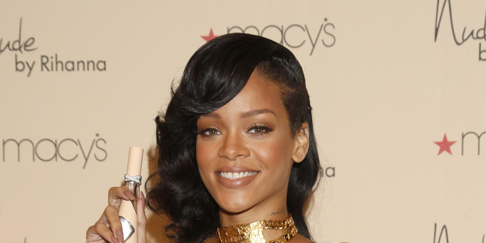 Rihanna launches Nude perfume, wears Chris Brown gold