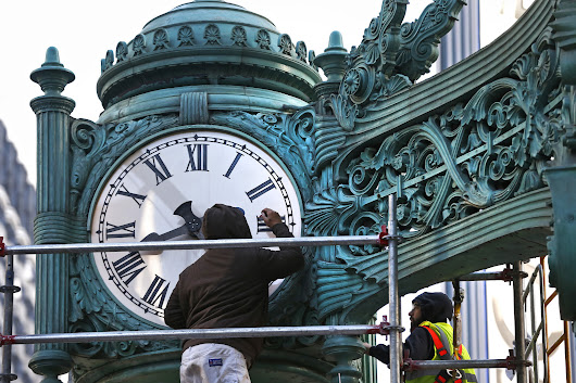 Clocks on State Street store getting paint job and polish