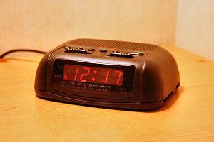 A basic digital clock radio with analog tuning