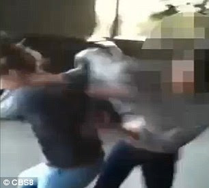 Baileigh tries to shield herself from her attacker but the other girl grabs onto her sweatshirt and keeps hitting her