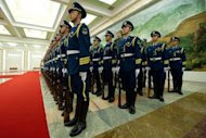 A Chinese honour guard prepare for a welcoming ceremony for Cuba's President Raul Castro at the Great Hall of the People in Beijing. China has pledged financial aid to Cuba as it undertakes historic economic reforms, promising Castro a new credit line as well as help in health care and technology