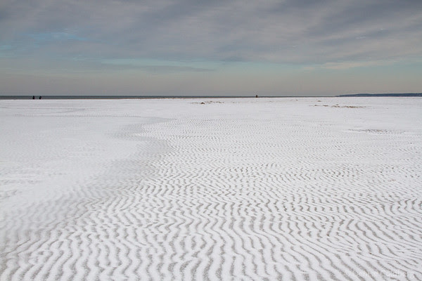 ripples in sand, covered with snow