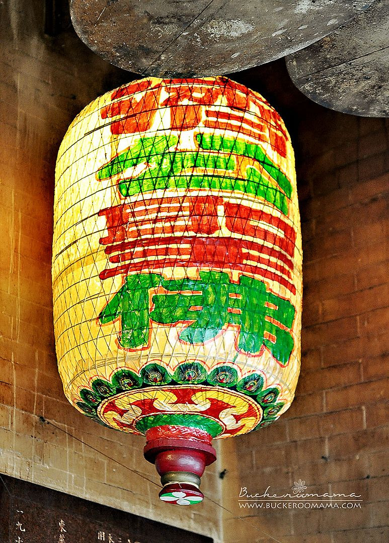 A lantern hanging by the door of a temple
