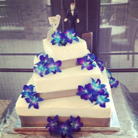 3 tier, 6 layer wedding cake with blue orchids by Anna