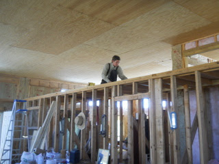 Robert Putting Plywood Down on Closet Ceiling