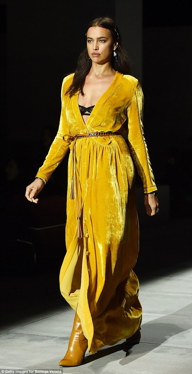 Supermodel: She looked every inch the supermodel as she owned the runway in yellow velvet couture