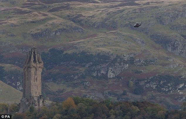 helicopter flies past Stirling Castle