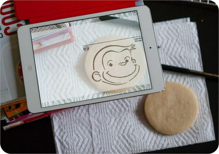 an iPad app that allows you to trace images onto cookies for decorating ... great alternative to a KopyKake