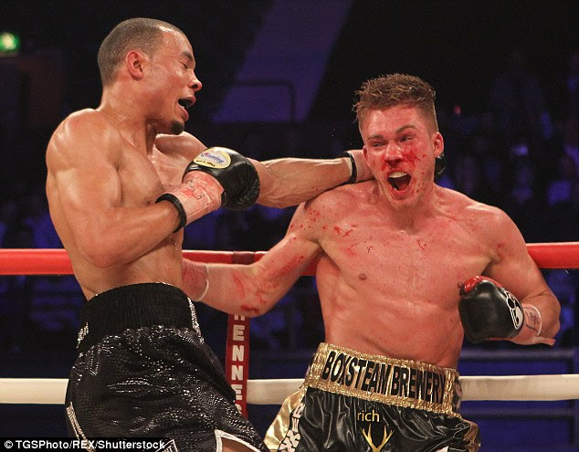 A bloody Nick Blackwell is punched by Chris Eubank jnr during their fight at the Wembley Arena in March