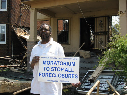 Supporter of a moratorium on foreclosures in Michigan standing outside a home that exploded on Lee Place near Woodrow Wilson on Detrot's west side, May 5, 2008. The home had been foreclosed. (Photo: Alan Pollock). by Pan-African News Wire File Photos