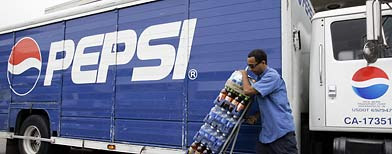 A Pepsi delivery worker delivers varioius drinks to a restaurant in Pacifica, Calif., Thursday, July 12, 2006. PepsiCo Inc., the No. 2 soft-drink maker, said second-quarter profit jumped 14 percent, helped by sales of non-carbonated beverages. (AP Photo/Paul Sakuma)