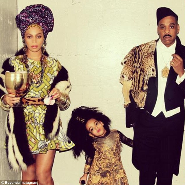 She's his Queen! Beyonce and Jay Z rock Coming To America costumes as they take Blue Ivy to watch Halloween parade in a snap posted to Bey's Instagram