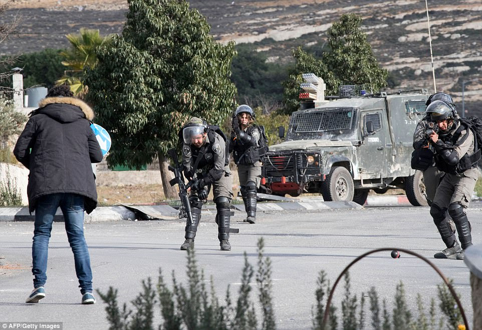 Dramatic pictures capture the moment Israeli troops opened fire on a Palestinian after he knifed one of the soldiers in the shoulder