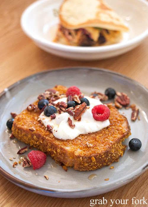 Crunchy brioche French toast with blueberries, yoghurt, roasted pecans and maple syrup