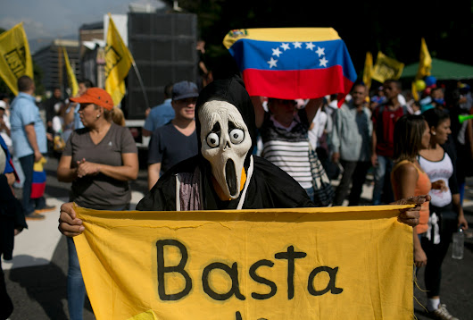 One dead, several injured and hundreds detained in increasingly turbulent Venezuela