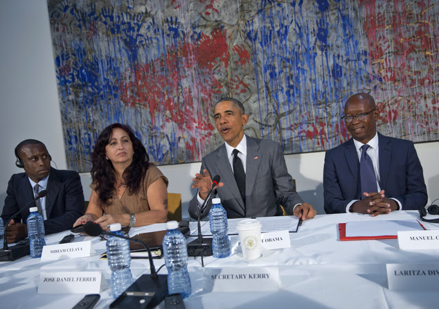 President Barack Obama meets with dissidents and other local Cubans at the U.S. Embassy, Tuesday, March 22, 2016, in Havana, Cuba. From left are., Nelson Alv...