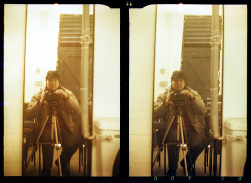 reflected self-portrait with Stereo Puck camera and borrowed hat by pho-Tony