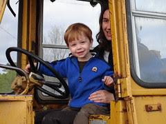 Tractor boy smiles