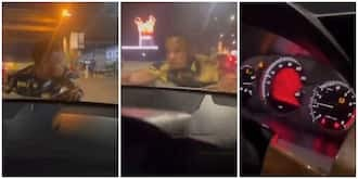 Wahala! As Man Hangs on to Bonnet of Moving Car Because Lady Refused Giving Him Cash, Video Goes Viral