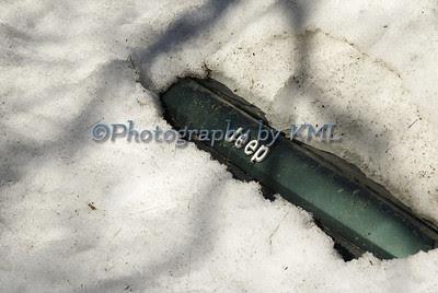 jeep peeking through the snow