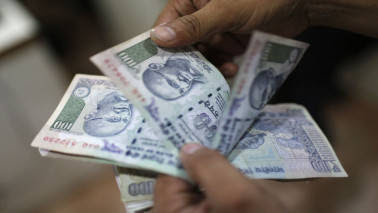 Rupee dives to 3-week low of 64.59 against dollar