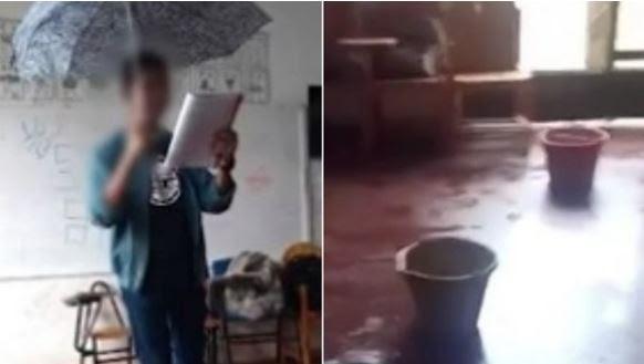 Estudante usa guarda-chuva dentro da sala de aula por causa de goteiras em escola