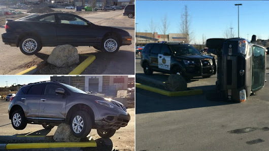 Drivers keep hitting large rock in suburban Calgary parking lot