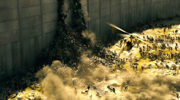 Like a swarm of fire ants, a horde of zombies attempt to scale a large wall protecting Jerusalem in WORLD WAR Z.