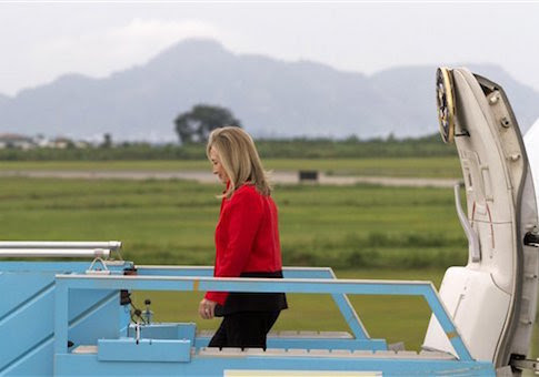 Secretary of State Hillary Rodham Clinton arrives at Abuja International Airport in Abuja, Nigeria, Thursday, Aug. 9, 2012